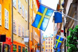moving to sweden to see street in stockholm with flags